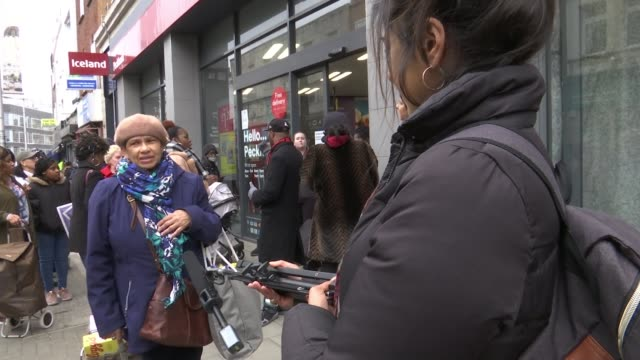 supermarkets ration key items as the supply chain tries to respond to crisis england london peckham ext iceland sign crowd gathered outside... - group of people stock videos & royalty-free footage