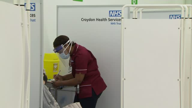 surge in cases in london and south east of england; england: london: croydon: int 'vaccination hub' sign in covid-19 vaccination centre medical... - croydon england stock videos & royalty-free footage