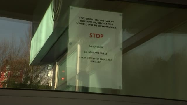 surgery in brighton closes after gp diagnosed with coronavirus; england: brighton: ext gv sign 'if you suspect you may have, or have come into... - general practitioner stock videos & royalty-free footage