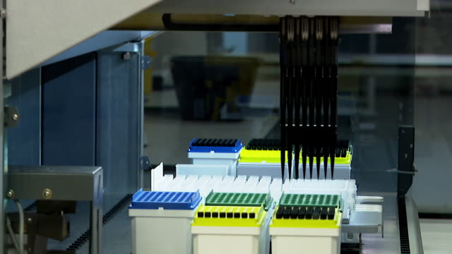 """coronavirus swab tests being processed in laboratory in milton keynes - """"bbc news"""" stock videos & royalty-free footage"""