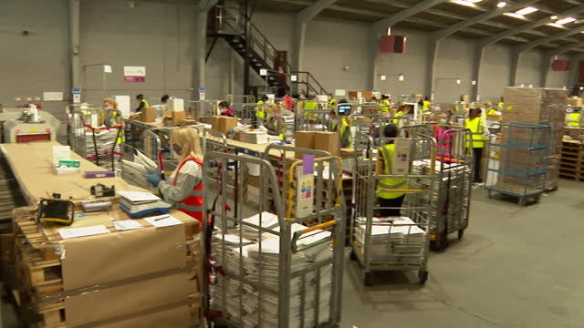 coronavirus swab tests packaged up at distribution centre to be sent out to the community for the imperial college london react study - epidemic stock videos & royalty-free footage