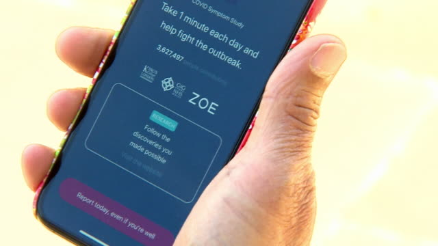 coronavirus symptoms app from kings college london being used - wireless technology stock videos & royalty-free footage