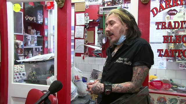 tattoo studios allowed to re-open; uk, england, london; tattoo studio re-opening with measures to stop spread of covid-19, various shots of tattoo... - kentish town stock videos & royalty-free footage