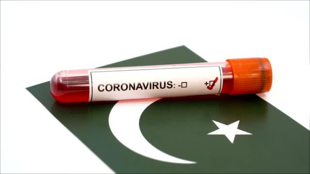 coronavirus test and pakistani flag - pakistani flag stock videos & royalty-free footage
