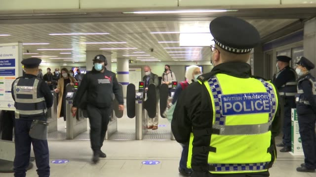 tfl and british transport police on patrol to enforce use of face coverings in capital; england: london: int general views of people through ticket... - itv london lunchtime news stock videos & royalty-free footage