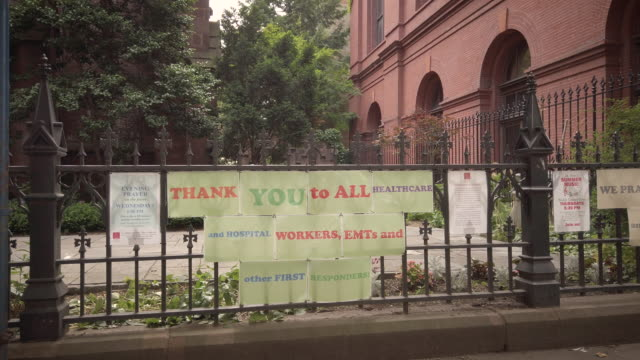 nyc coronavirus thank you signs in front of st ann the holy trinity church on montegue and clinton street the signage reads thank you to all health... - アトモスフィア点の映像素材/bロール