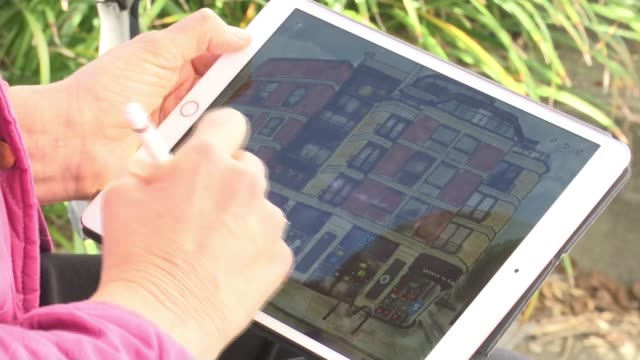 the secret artist who paints kentish town in lockdown; england: london: kentish town: ext over shoulder view the secret artist nw5 painting on ipad... - kentish town stock videos & royalty-free footage
