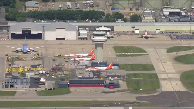 those coming into the uk from abroad will have to self-isolate for two weeks; england: west sussex: gatwick airport: ext air view / aerial grounded... - gatwick airport stock videos & royalty-free footage