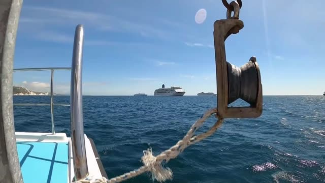 thousands of cruise line workers stranded at sea as foreign ports refuse to let them disembark; off coast of weymouth: ext point of view shots from... - report produced segment stock videos & royalty-free footage