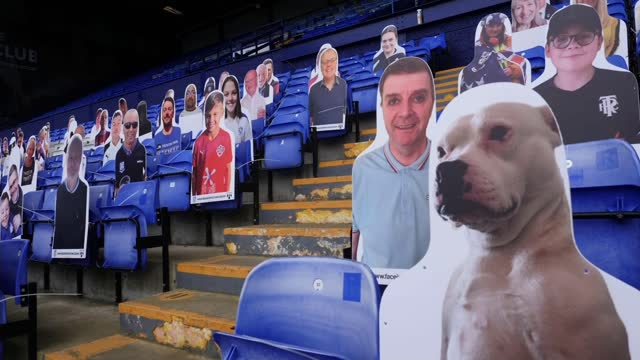 """tranmere rovers chair criticises """"complete lack of leadership"""" from fa heads; england: merseyside: birkenhead: prenton park: ext gvs players along... - fan enthusiast stock videos & royalty-free footage"""