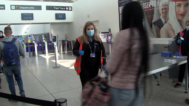travellers in stansted airport; filmed england: essex: stansted airport: int gvs check-in queue for ryanair flight / workers behind perspex shield at... - security stock videos & royalty-free footage
