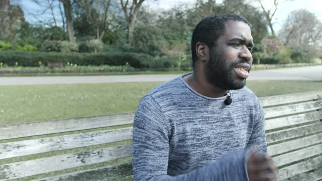 tyrone lewis' poem captures struggles of past year; england: ext tyrone lewis reading poem sot - literature stock videos & royalty-free footage