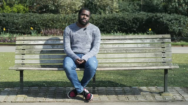 tyrone lewis' poem captures struggles of past year; england: ext various of tyrone lewis reading poem sot - literature stock videos & royalty-free footage