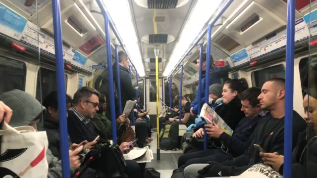 can 'turn the tide' within 12 weeks, says boris johnson; england: london: int passengers down escalator on london underground passenger seated in... - ロンドン地下鉄点の映像素材/bロール