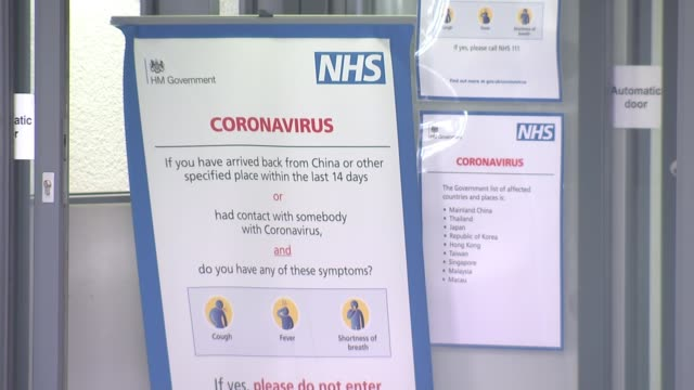 uk cases increase by 67 in 24 hours england coronavirus information poster on window beside hospital entrance gv entrance and sign 'emergency... - information sign stock videos & royalty-free footage