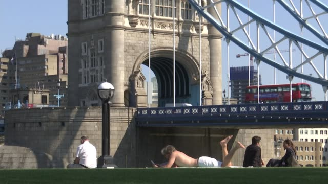 coronavirus cases at four month high for second consecutive day; england: london: ext paul scully mp interview sot southwark: man sunbathing on grass... - picnic stock videos & royalty-free footage