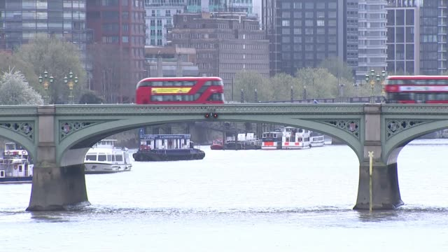 stockvideo's en b-roll-footage met uk death toll exceeds 11000 as sir patrick vallance says that testing was inadequate as the virus spread england london ext bus along otherwise... - leeds