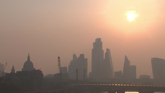 falls into recession as gdp plunges; england: london: ext / dawn sunrise over city of london skyscrapers with river thames in foreground [during... - office block exterior stock videos & royalty-free footage