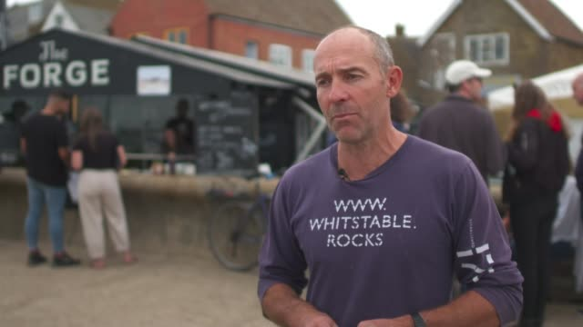 grows by over 6 per cent in july; england: kent: whitstable: ext various of worker at seafood shop shucking oysters james green interview sot. - mollusc stock videos & royalty-free footage