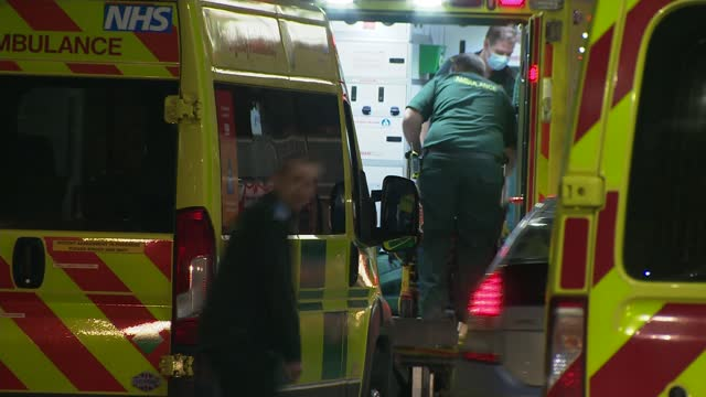 public urged to stay home for new year's eve as covid hospital patients rise; england: london: ext / dusk ambulances parked outside hospital... - ambulance stock videos & royalty-free footage