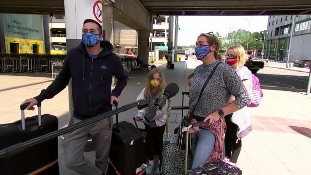 tourists return home from spain to face two weeks quarantine; england: sussex: gatwick airport: ext easyjet aircraft taxiing vox pops sot. - tourist stock videos & royalty-free footage