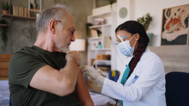 coronavirus vaccination - giving stock videos & royalty-free footage