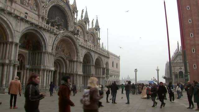 venice gvs; italy: venice: ext various shots of pedestrians - tourists - in st mark's square wearing medical face masks / group of people dressed in... - italian culture stock videos & royalty-free footage