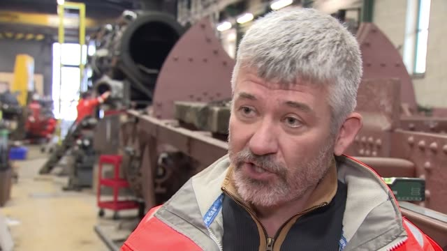 view from devon; england: devon: int gv train engineers welding close shot welding gv steam train in workshop and mechanics along gv mechanics left... - locomotive stock videos & royalty-free footage