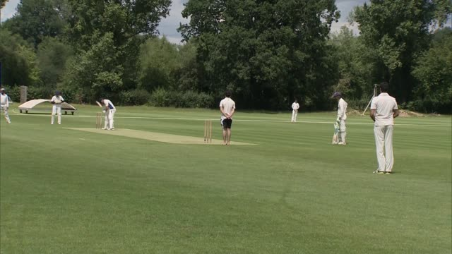 village cricket returns as lockdown restrictions lifted england surrey slough old merchant taylors cricket club ext coronavirus social distancing... - handle stock videos & royalty-free footage