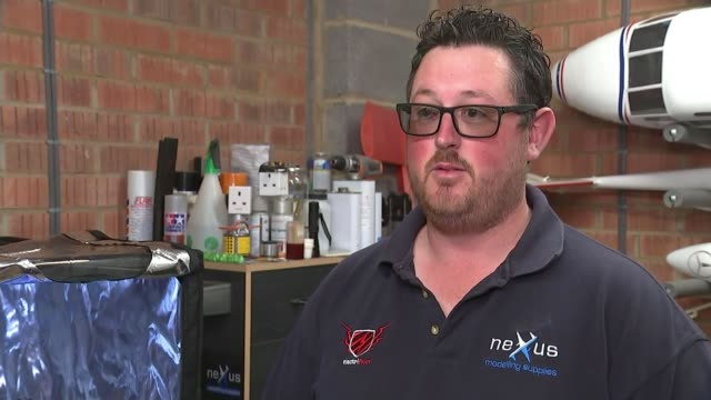 stockvideo's en b-roll-footage met volunteer ppe producers forced to stop due to new safety regulations england somerset int kyle millett cutting 3d printed parts close shot of 3d... - new not politics
