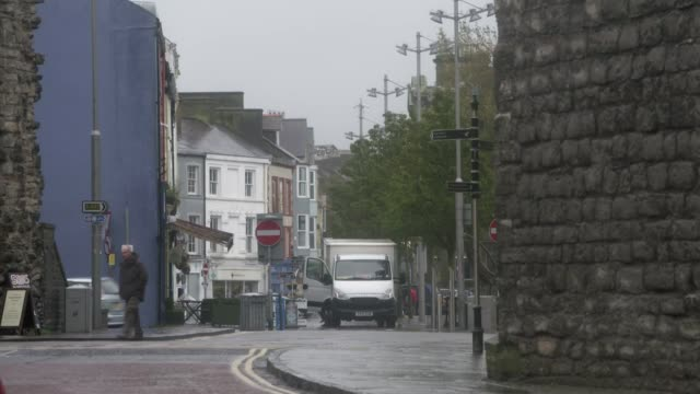 wales first minister seeks travel restrictions on visitors from england covid hotspots wales general views of people along streets wearing masks - pursuit concept stock videos & royalty-free footage
