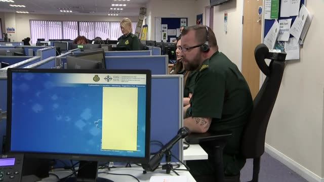 wales rolls out video consultations to help people self-isolating; swansea, uk; various shots of ambulance call centre operators at work, jason... - general practitioner stock videos & royalty-free footage