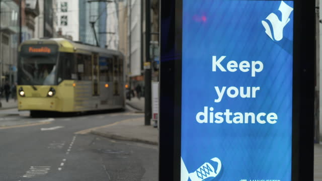 coronavirus warning signs around manchester - commercial land vehicle stock videos & royalty-free footage