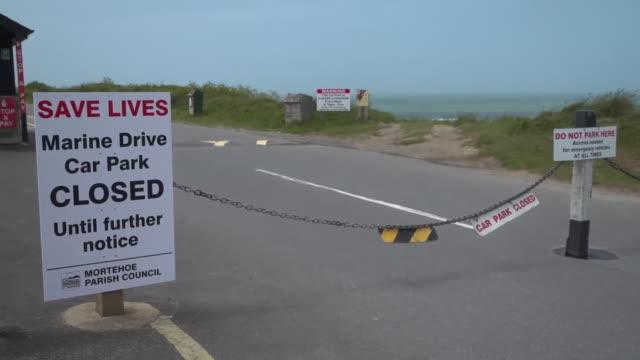coronavirus warning signs around uk coastal resorts - tourist resort stock videos & royalty-free footage