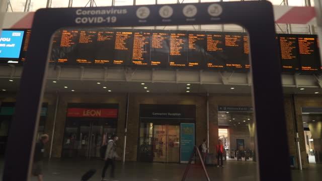 coronavirus warnings at a london train station - railway station stock videos & royalty-free footage