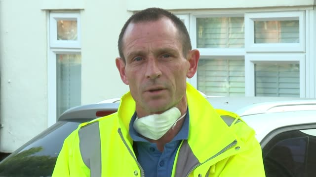 waste collectors speak about working during lockdown; england: london: harrow: ext bin lorry along street past wheelie bins int car gerry woodman... - bin stock videos & royalty-free footage