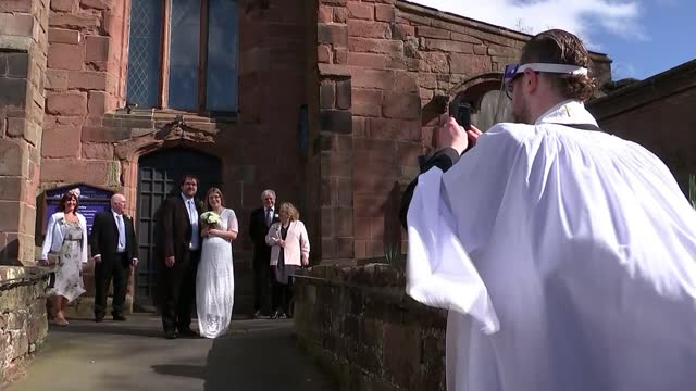 weddings are now allowed in england with maximum of six people; england: staffordshire: newcastle-under-lyme: ext wide shot of church as wedding... - guest stock videos & royalty-free footage