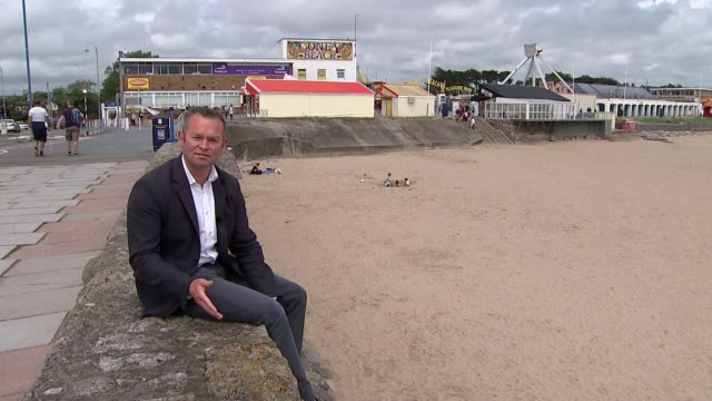 welsh government to ease lockdown restrictions further and may allow holidaymakers to return from july; wales: porthcawl: ext coney beach pleasure... - directional sign stock videos & royalty-free footage