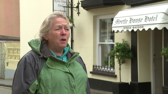 welsh government to ease lockdown restrictions further and may allow holidaymakers to return from july wales tenby beach town boats fishing fish and... - fortress stock videos & royalty-free footage