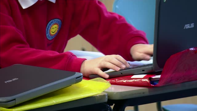 welsh schools could start to reopen after february half term; wales: caerphilly: aberbargoed primary school: int tracking shot along school corridor... - tracking shot stock videos & royalty-free footage