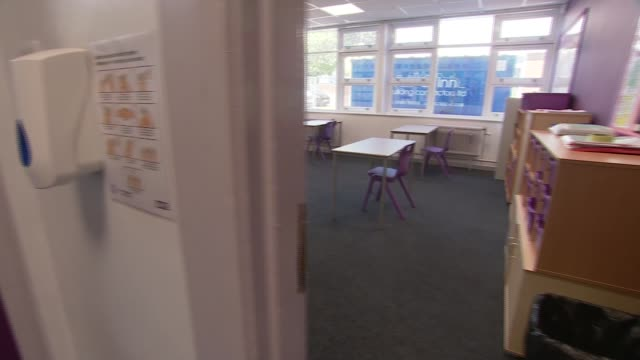 welsh schools to reopen at the end of june wales int '2 mtr distance' and footprints sign on floor of school corridor poster with handwashing... - footprint stock videos & royalty-free footage