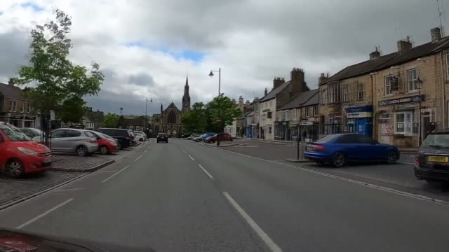 witness claims that dominic cummings was seen in barnard castle england county durham barnard castle shot as along road through town ext pan across... - tracking shot stock videos & royalty-free footage