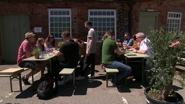 government is being warned not to rush into lifting covid restrictions; england: derbyshire: derby: ext people sitting in circle on grass people... - drinking stock videos & royalty-free footage