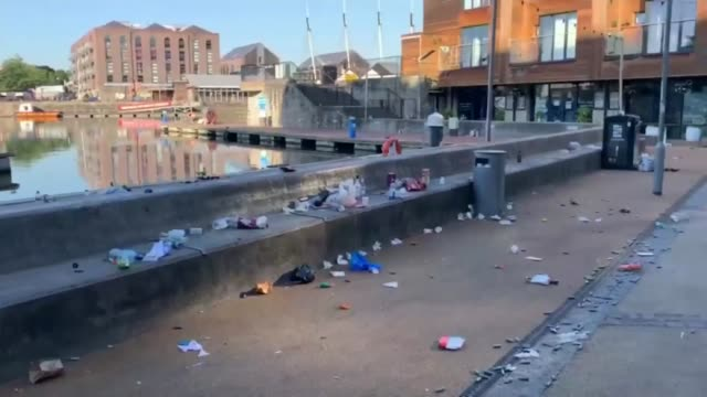 "litter levels reaching ""epidemic"" levels as lockdown eases; england: ext litter left on pavement and benches in dock marina area - marina stock videos & royalty-free footage"