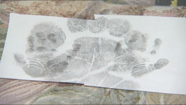 stockvideo's en b-roll-footage met coroner criticises milton keynes hospital over death of baby; int handprints and footprints of baby ebony mccall - lijkschouwer