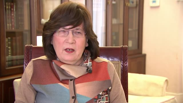 Coroner in court accused of ignoring religious beliefs by refusing to fast track burials London INT Eva Klein interview SOT Hands