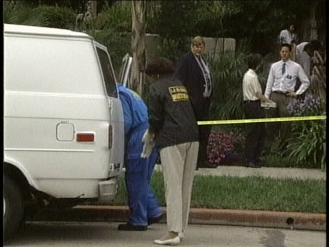 coroners remove body from crime scene where nicole brown simpson resided. - orange juice stock videos & royalty-free footage