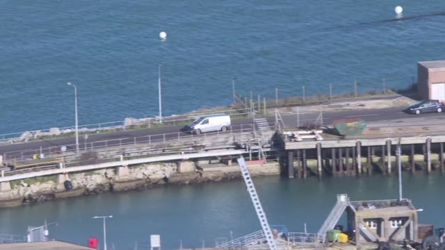 A coroner's van is among a fleet of cars leaving Portland Port in Dorset where the Geo Ocean III boat docked following a search for the bodies of...