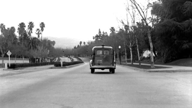 a coroner's van travels down sunset boulevard in beverly hills, california. - 1949 stock videos & royalty-free footage
