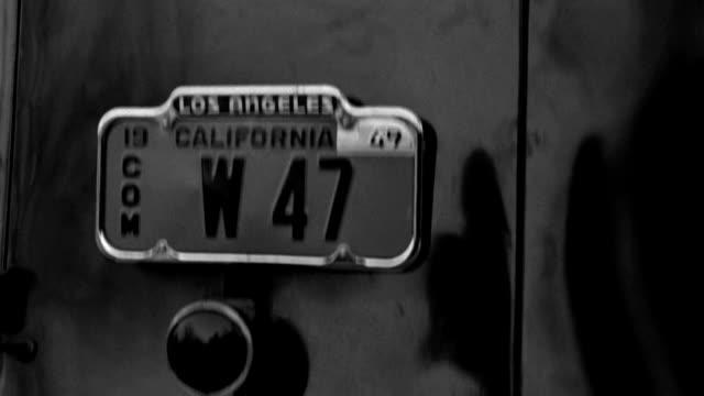 a coroner's van travels down sunset boulevard in beverly hills, california. - sunset boulevard stock-videos und b-roll-filmmaterial